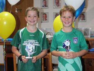 U8 boys winner Jamieson and runner-up Campbell.