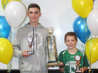 Winners of the Margaret Saunders Award for best first-year athletes, Guy (senior) and Jamieson (little aths).