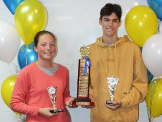 Winners of the Norm McKenzie Award for most accumulated points, Emma (senior) and Seth (junior).