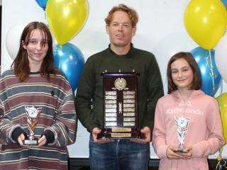 Winners of the President's Trophy encouragement award Charlotte (senior) and Josien (little aths) with club president Michael Thornton.