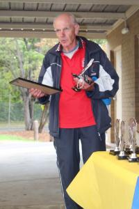 Men's 60+ - winner Michael Orelli with Geelong Athletics 25-year special recognition certificate